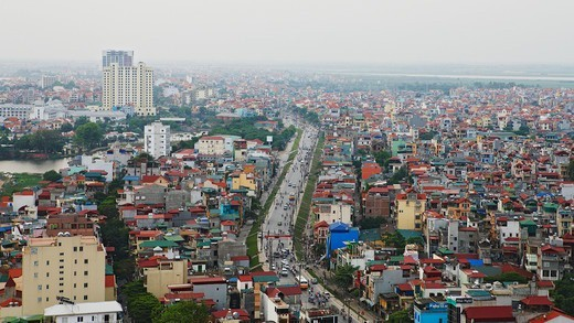 Stock Photo: 4347-295 A view of Hanoi on a hazy day from the Sofitel Hotel, down Nghi T'am, Vietnam. The city is quite populous.