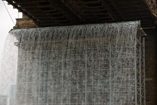 Stock Photo: 4351-231 Artist Olafur Eliasson created a series of artificial waterfalls in and around Manhattan and New York harbor, like this one under the Brooklyn Bridge.