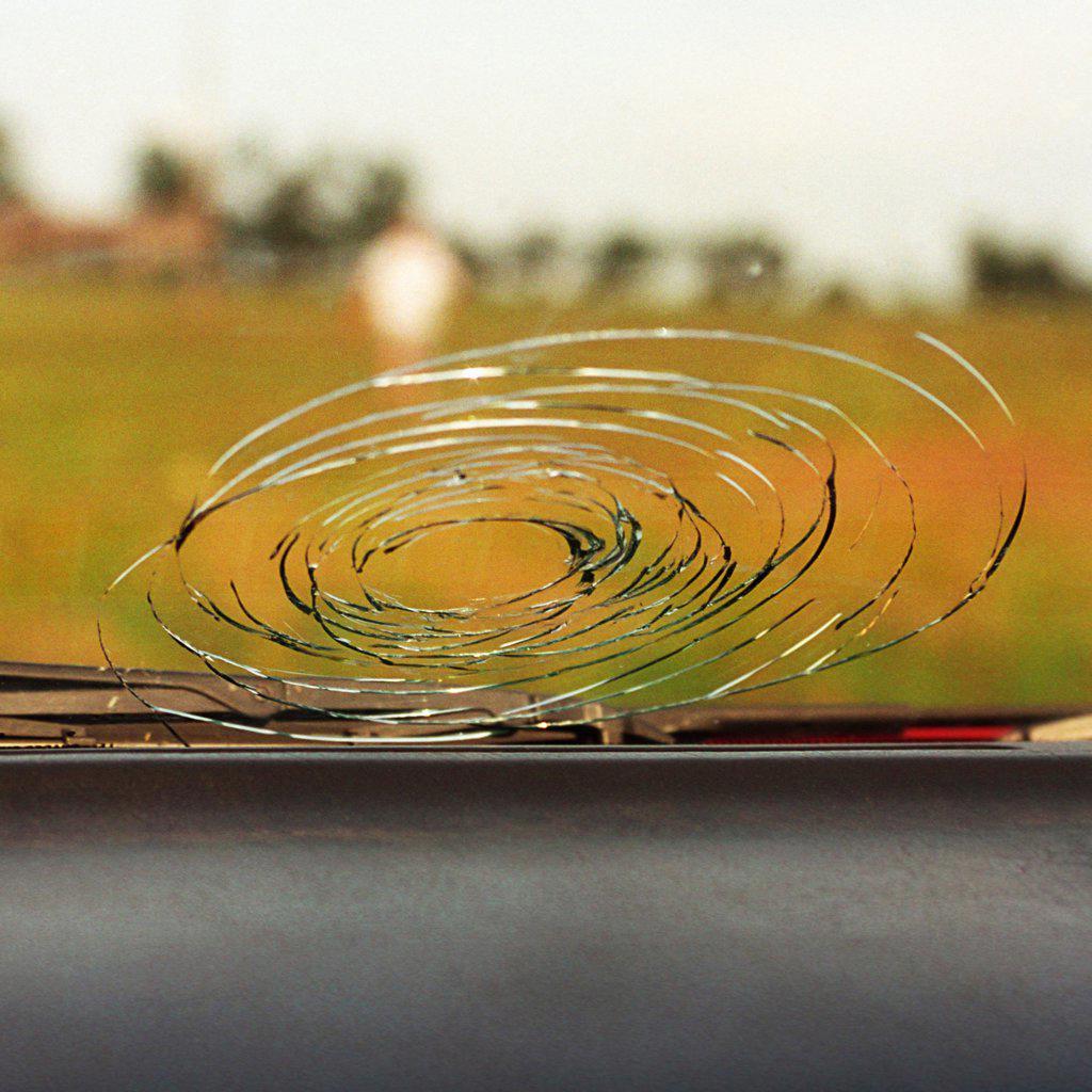 Stock Photo: 4354-188 A Car Windshield Damaged by Hail