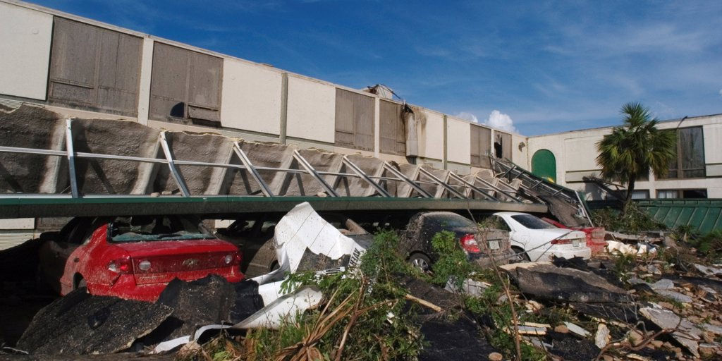 Stock Photo: 4354-210 Cars Crushed by Rubble After Hurricane Charley