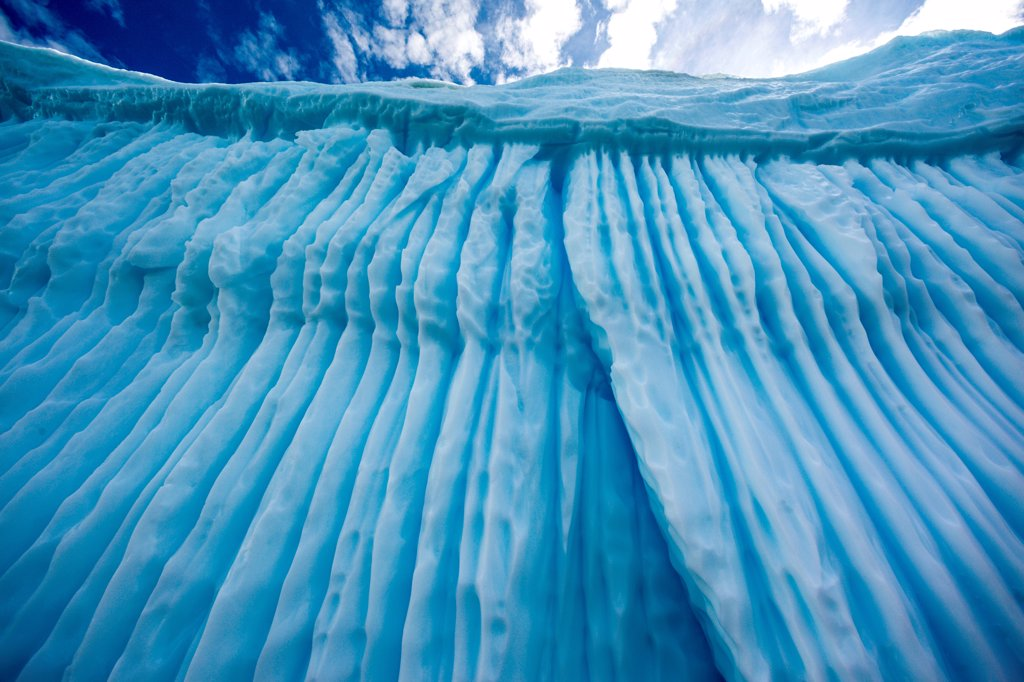 Stock Photo: 4355-2133 A massive striated iceberg which has turned over many times off of Danko Island in Antarctica