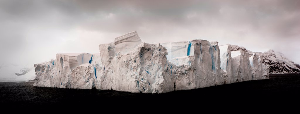 Stock Photo: 4355-2161 Massive Tabular Iceberg in  Neko Harbor. Neko Harbor located in Andvord Bay at the southern end of the scenic Errera Channel in Antarctica and surrounded by active glaciers.