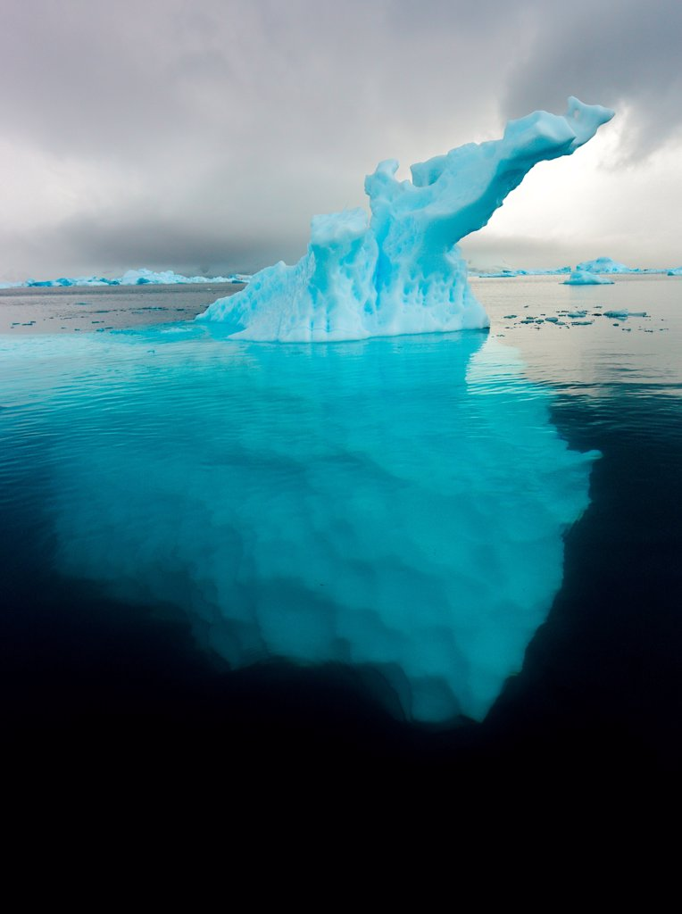 View of Iceberg extending deep into the ocean in Paradise Cove, Antarctica : Stock Photo