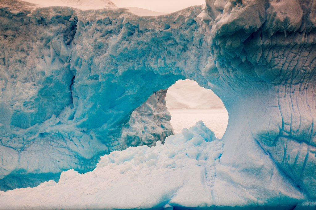 Stock Photo: 4355-2227 An hole in a large tabular iceberg in Wilhelmina Bay, Antarctica