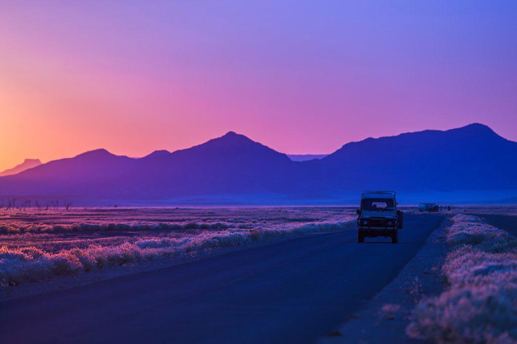 Stock Photo: 4355-2418 Namibia, Namib-Naukluft National Park, Soussusvlei, 4x4 on desert road