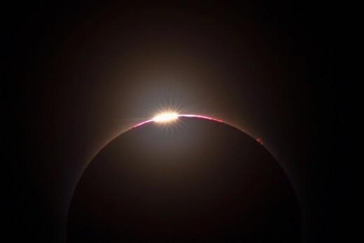 Stock Photo: 4356-168 Diamond Ring Effect Peeks Out from Behind Scattered Clouds at the Onset of Totality During Solar Eclipse of July 22, 2009 near Hangzhou, China