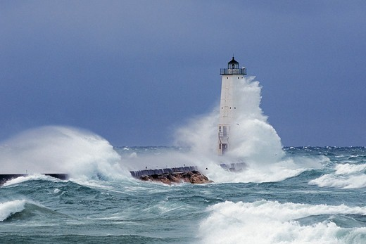Fierce Winter Storm Rages Against the Frankfort, Michigan Lighthouse : Stock Photo