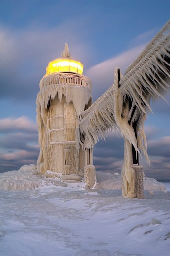 Stock Photo: 4361-148 Ice-Covered Lighthouse with Beacon Lit
