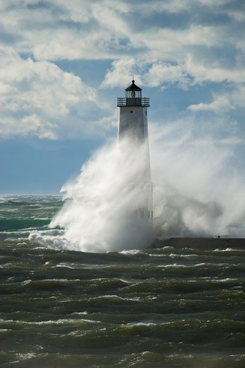 The 'Great Lakes cyclone' wind storm of October, 2010 overwhelms the Frankfort North Breakwater Lighthouse in Frankfort, Michigan. All shipping on the Great Lakes came to a halt during this ferocious storm. : Stock Photo