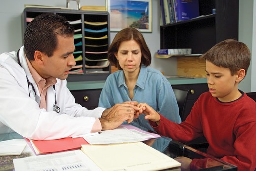 Mother and Son Consult with Pediatrician : Stock Photo