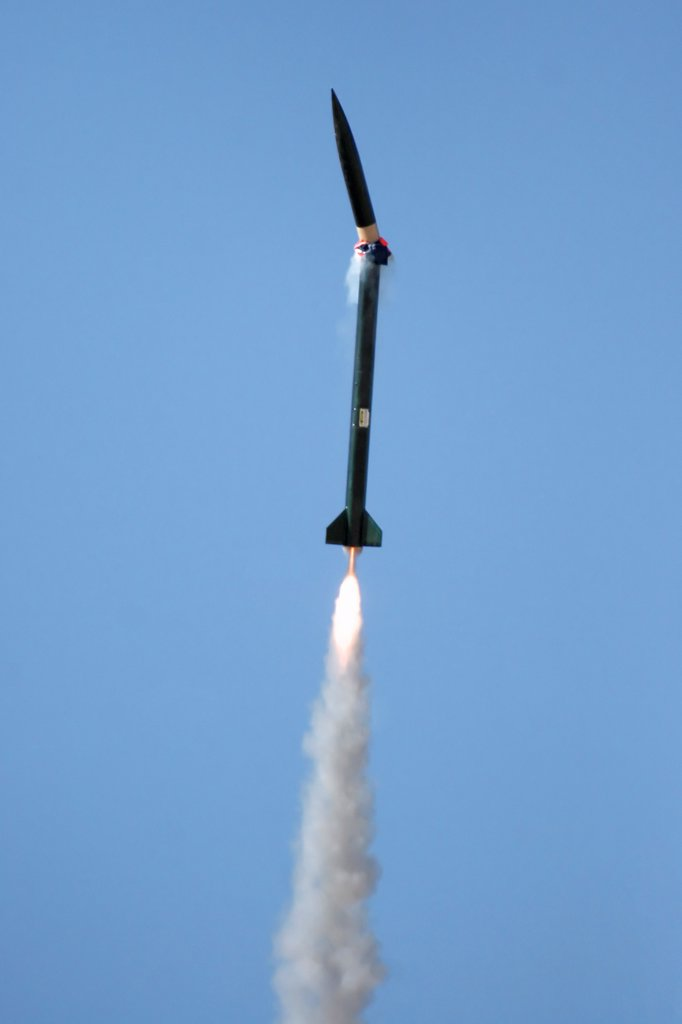 Stock Photo: 4367-228 A rocket experienences a CATO (Catostrophic on Take Off) failure as the nose-cone seperates prematurely from the rocket at launch. This was at a launch event sponsored by the Southern Arizona Rocketry Association (SARA).