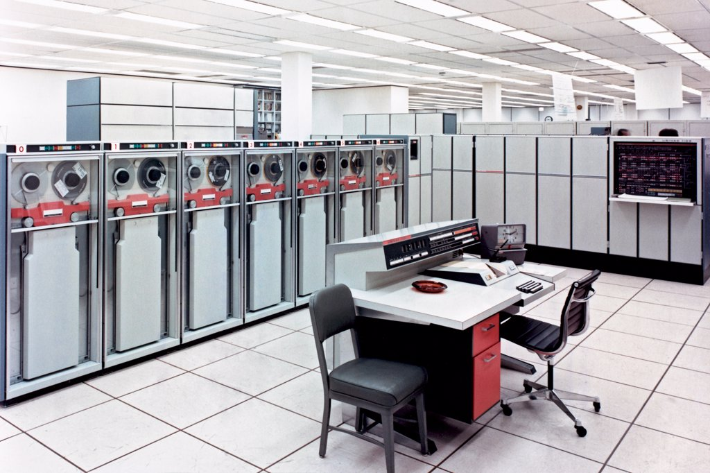 Stock Photo: 4368-153 A state-of-the-art Univac 110811, circa 1967, which was one of four such machines installed in the Computation and Analysis Division facility in the Manned Space Flight center's Building 12. The computers were used to support the scientific and management environments of the Manned Spacecraft Center.
