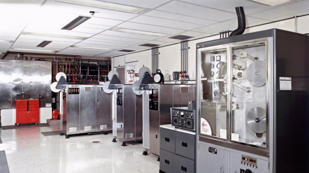 Stock Photo: 4368-186 State-of-the-art high speed motion picture processors, black-and-white film processing machines, and an ultrasonic film cleaning machine.