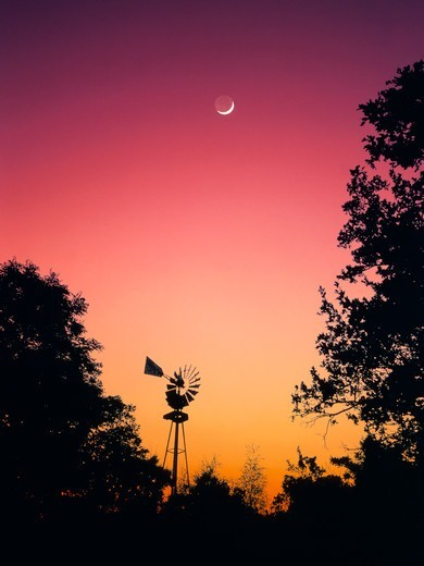 Windmill, Red Sky, and Cresent Moon : Stock Photo