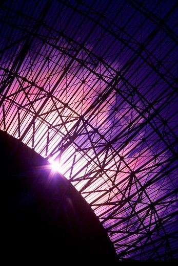 Radio Telescope Structure with Sun and  Iridescent Clouds : Stock Photo