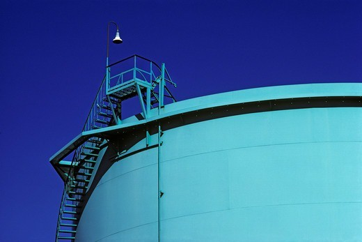 An oil storage tank and stairs, designer colored, Long Beach, California.  As an incidental byproduct of their function, the aesthetic grace of these structures make them fitting symbols of the age of fossil fuels. : Stock Photo