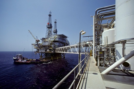 An oil drilling platform seen from its companion production platform, off of Long Beach, California. : Stock Photo
