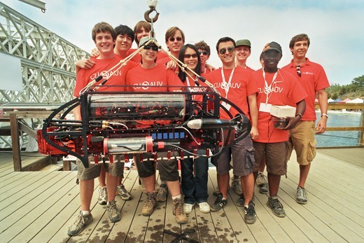 Cornell AUV and Event Team, all smiles as their entry was the only one to complete the mission of some 30 others.  They won the first place prize of $20,000.00. Victorious in 2003, they have been skunked ever since, up till now. SPAWAR Transducer Test Facility, San Diego, 12th International Autonomous Underwater Vehicle Competition, sponsored by the Association for Unmanned Vehicle Systems International (AUVSI) and the US Office of Naval Research. August 2, 2009.The mission is to 'Create a subme : Stock Photo