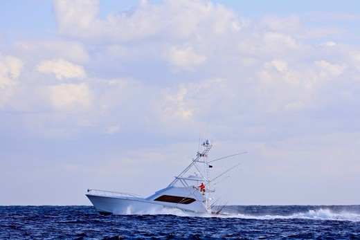 Sportfishing boat cruising off the coast of Isla Mujeres. : Stock Photo