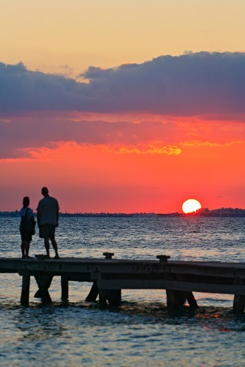 Stock Photo: 4372-740 Couple watches the sun set on Isla Mujeres.