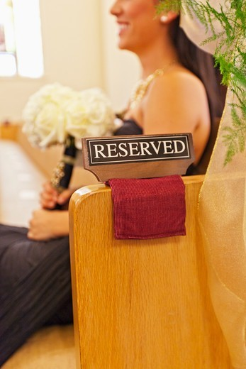 Bridesmaid in reserved seating. : Stock Photo