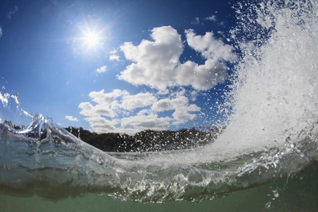 USA, Hawaii, Big Island, Hapuna Beach, Scenic view of clouds and breaking wave : Stock Photo
