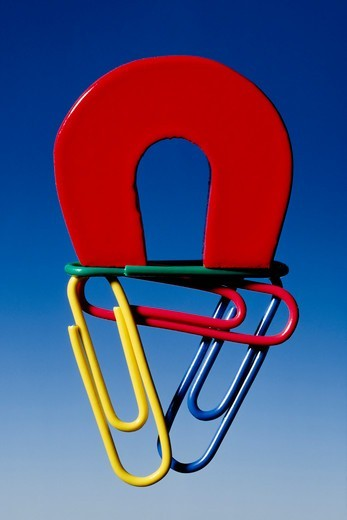 Magnet and Paper Clips : Stock Photo