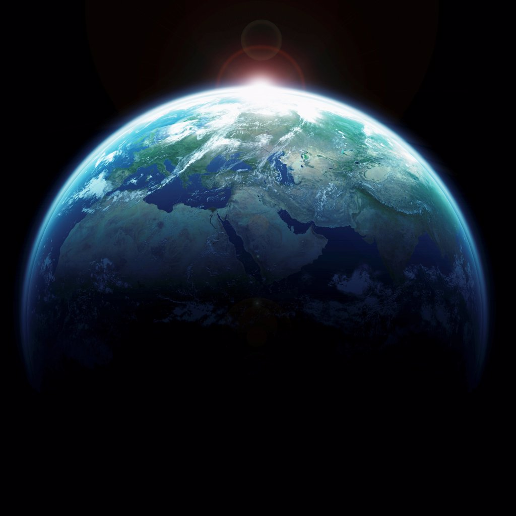 Sunlight emanating from behind planet earth. : Stock Photo