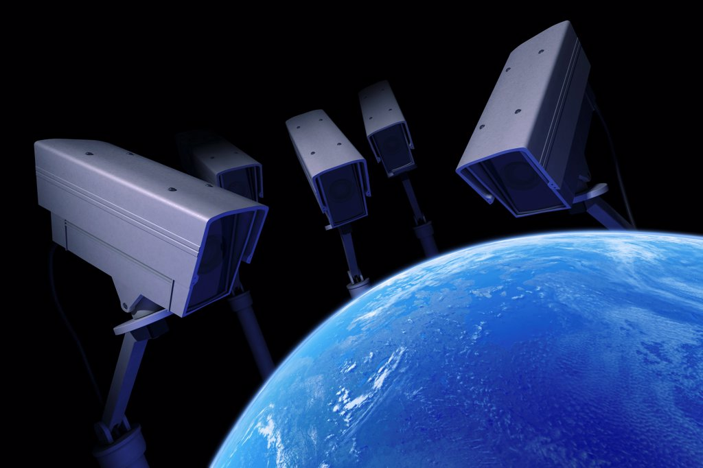 Security cameras monitor the earth. : Stock Photo