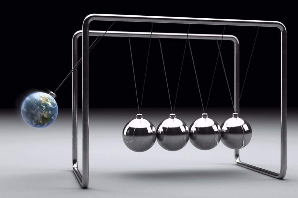 Stock Photo: 4378-647 Conceptual illustration close-up of a Newton's cradle where one of the spheres has been replaced by an earth.