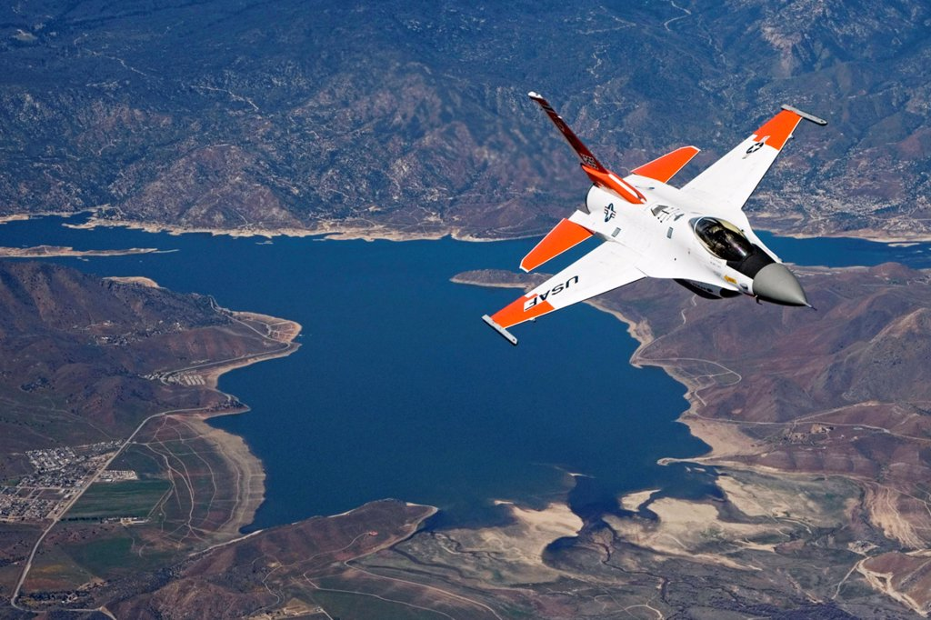 An F-16 Fighting Falcon fitted with radio frequency identification tags flies behind a test tanker on an aerial flight test over Isabella Lake near Edwards Air Force Base, California.  The mission tested the Automatic Receiver Aircraft Identification system on the tanker. (U.S. Air Force photo by Chad Bellay) : Stock Photo