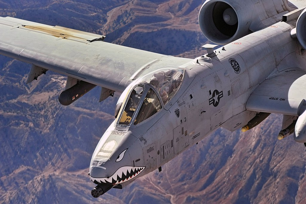 Stock Photo: 4382-233 A close-up view of an A-10 Thunderbolt II, also known as a Warthog, in flight over Afghanistan. The cockpit and front-mounted machine-gun are clearly visible. A-10s provide close-air support to ground troops in Afghanistan and Iraq. (U.S. Air Force by photo by Staff Sgt. Aaron Allmon)