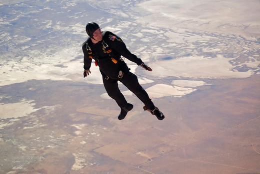 Stock Photo: 4387-108 Skydiver Over Edwards Air Force Base