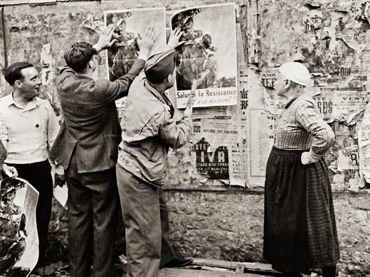 Stock Photo: 4388-1100 One Soldier and Three Civilians Post Resistance Posters