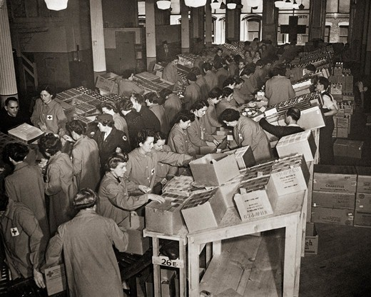 Red Cross Workers Packing Boxes to go to the United States Armed Forces and Prisoners of War : Stock Photo