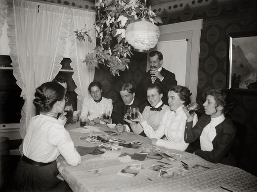 Orville Wright and Women Looking at Photos : Stock Photo