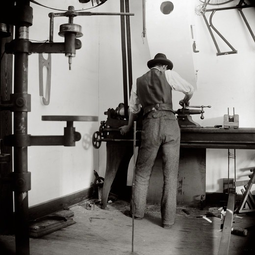 Stock Photo: 4388-210 Inventor Wilbur Wright Works in the Bicycle Shop