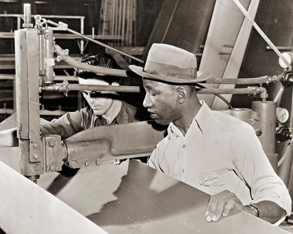 Stock Photo: 4388-979 Men Building Aircraft