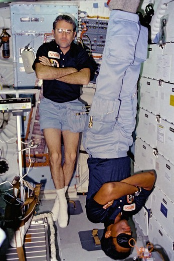 Stock Photo: 4389-2265 Astronauts Truly and Bluford Asleep on Middeck