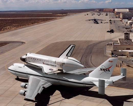 Stock Photo: 4389-709 Space Shuttle and Carrier Taxing to Runway