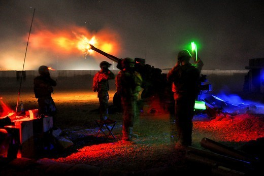 Third Platoon, Bravo Battery of the Automatic Battalion, 2nd Battalion, 8th Field Artillery Regiment, lit up the Zabul province night by firing illumination from their M777A2, 155 mm howitzer at suspected enemy movements from FOB Pasab, Zharay District, Zabul province, Afghanistan, July 20. (Photo by Sgt. Christopher McCann) : Stock Photo