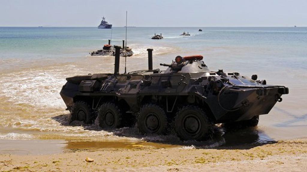 Ukrainian Armored Personnel Carriers Arrive Ashore During Amphibious Beach Landing Demonstration : Stock Photo