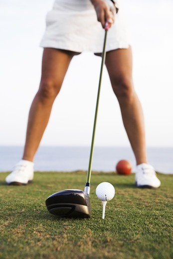 A woman playing golf by the sea, Gran Canaria, Spain. : Stock Photo