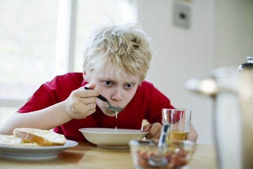 Stock Photo: 4400R-1985 A boy having soup for dinner, Sweden.