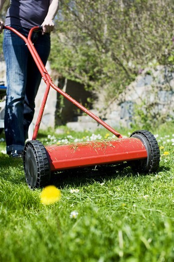 Stock Photo: 4400R-2034 A woman moving the lawn, Sweden.