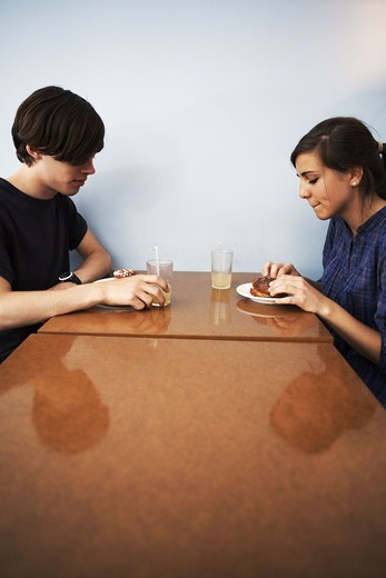 Stock Photo: 4400R-2454 A young couple in a cafe, Sweden.