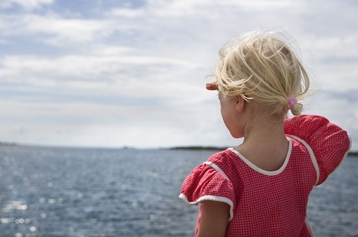 Stock Photo: 4400R-2791 A girl by the ocean, Sweden.