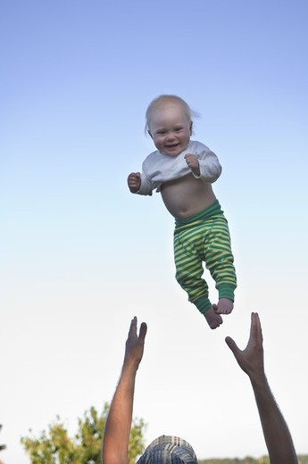 A baby in the air, Sweden. : Stock Photo