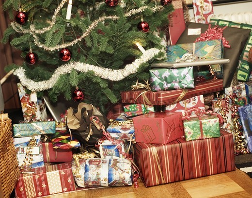Stock Photo: 4400R-2953 Christmas presents under the Christmas tree, Sweden.