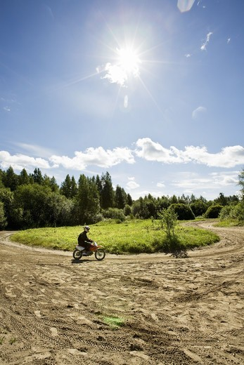 Stock Photo: 4400R-3151 Boy on a motocross, Finland.